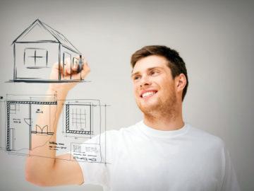 Мужчина рисует дом маркером